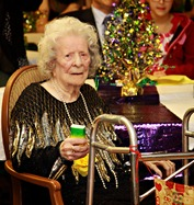 Ms. Francis celebrating her 104th Mardi Gras