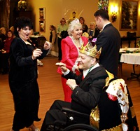 The King and Queen dancing with relatives.